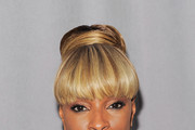 Mary J. Blige poses backstage at the 2011 FiFi Awards at The Tent at Lincoln Center on May 25, 2011 in New York City.