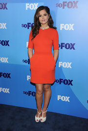 Cheryl Cole went for a pop of color at the Fox Upfront event in New York City wearing a tangy orange Giambattista Valli cocktail dress. The songstress wore white t-strap platforms and completed her look with soft waves in her hair.