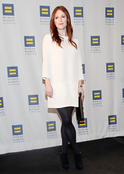 Julianne Moore kept her white shift dress winter appropriate with black suede ankle boots.