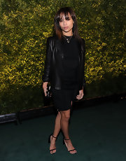 Zoe Kravitz oozed sophistication in black satin fall 2011 sandals featuring caped heels.