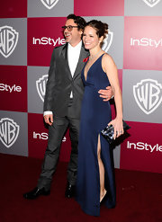 Susan Downey showed her daring side at the 2011 Golden Globes party in a blue evening dress with a plunging neckline and an up-to-there slit.