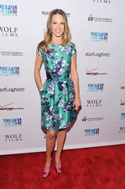 Hilary Swank gave a feminine finish to her floral print dress with fuchsia satin peep-toes.