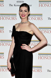 Anne Hathaway wore a pair of old European cut diamond stud earrings at the 34th Kennedy Center Honors.