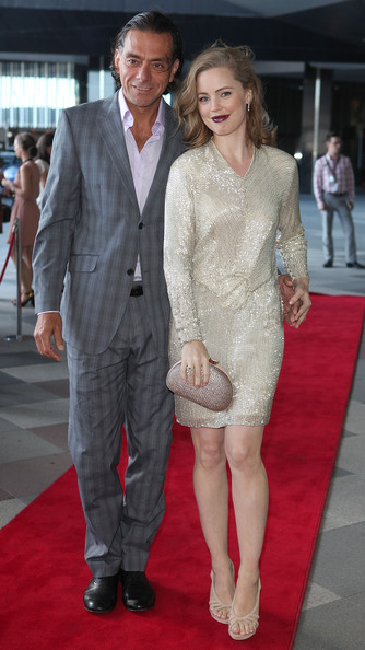 Melissa George paired her shimmering dress with nude cutout pumps.