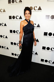 Lisa Edelstein looked refined on the red carpet in a silk navy halter gown at the MOCA Gala.