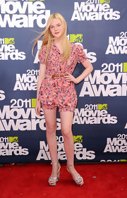 Elle Fanning was a doll at the MTV Movie Awards in a pink belted floral print romper.