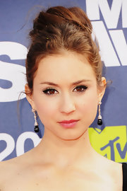 Troian Bellisario's dangling gemstone earrings and top-knot went together perfectly.