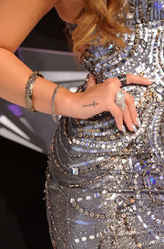 Demi Lovato's cross tattoo was on display amidst her sparkling jewelry at the 2011 MTV Video Music Awards.