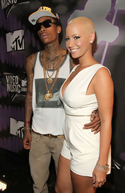 Wiz Khalifa wore long gold chains with circular pendants for the MTV Video Music Awards.
