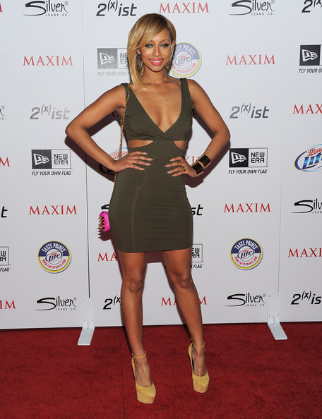 Keri looked sexy sexy in an olive green cutout dress for the Maxim Hot 100 Party.