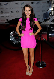 Camilla was a standout in this neon mini at the Maxim Hot 100 Party.