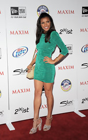 Melody went for an Easter green in a 3/4 sleeve cocktail dress at the Maxim Hot 100 party.