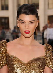 Crystal Renn loves a good red lipstick and she chose a lovely shade to wear at the Metropolitan Opera's season opener. To recreate Crystal's look, we recommend a super saturated, classic shade like NARS Lipstick in Jungle Red