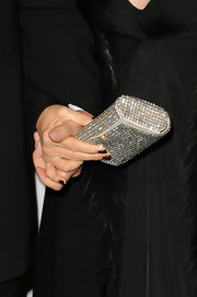 Barbra Streisand added some sparkle to her all-black ensemble with a gemstone-inlaid clutch at the 2011 MusiCares tribute.