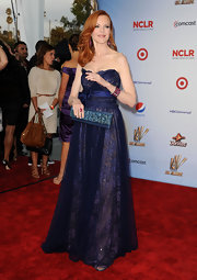 Marcia Cross accessorized her gorgeous ball gown with a navy satin and crystal clutch.
