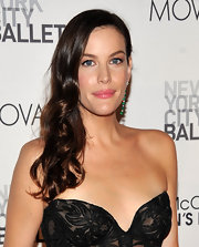 Liv Tyler wore a sheer, bubble-gum lip color to the New York City Ballet's fall gala. To recreate Liv's look, we recommend Bobbi Brown Brightening Lip Gloss in Popsicle and Benefit Ultra Shines Lip Shine in Life On The A List.