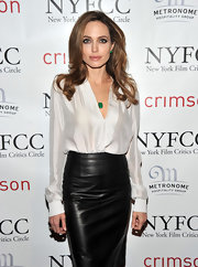 Angelina Jolie balanced the feminine with the strong in a deep-V blouse and a leather pencil skirt.