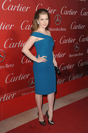 Amy Adams paired her phenomenal teal dress with metallic pewter platforms.