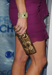 Lara Spencer's gold beaded clutch popped against her fuchsia cocktail dress.