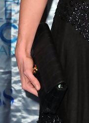 Cat Deeley added a classic touch to her blue carpet look with a timeless quilted Chanel clutch.