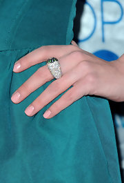 Ashley Bell attended the People's Choice Awards wearing a Peacock ring with diamonds, blue sapphires, garnet tsavorite and iolite.