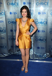 Lucy Hale paired her gorgeous mustard dress with strappy gold sandals. The glittery heels showcased her dark pedicure.