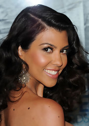 Kourtney Kardashian accentuated her bold brown eyes with defined lashes.