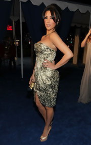 A retro styled Kim Kardashian donned nude platform pumps with her glimmering brocade dress.