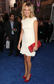 Malin Akerman gave her little white dress a dose of color with a red snakeskin clutch.