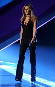 Jennifer dons a black vest with a deep plunging neckline for casual evening style.