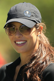 Ana Ivanovic got double sun protection with her aviators and baseball cap while watching the 2011 Presidents Cup.