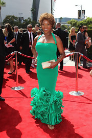 Alfrew Woodard donned a custom emerald green silk halter gown with pleated ruffle hem at the Creative Arts Emmys.