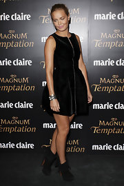 Lara Bingle paired her full black dress with black suede cuffed ankle booties.
