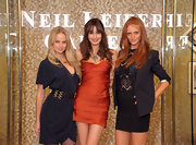 Cintia Dicker posed with fellow SI models wearing a sheer top, a bandeau skirt, and a matching navy blue blazer.