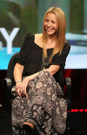 Lisa Kudrow paired a loose black blouse with a long print skirt for a boho finish during the 2011 Summer TCA Tour.