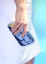 Maggie Q carried an ultra-stylish etched metal clutch when she attended the 2011 Teen Choice Awards.