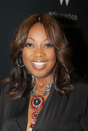 Star Jones paired her plunging neckline with a red and silver statement neckalce.
