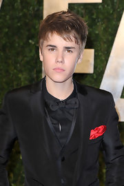 Justin wears a black satin bow tie to top off his dapper ensemble at the Vanity Fair Oscar party.