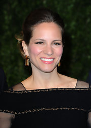 With her chignon and black column dress, Susan Downey was all about simple elegance at the 2011 Vanity Fair Oscar party.