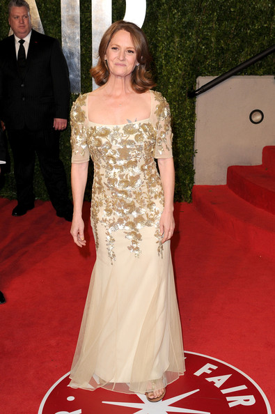Melissa changed into a gold encrusted evening gown at the Vanity Fair Oscar party after have recently won the best supporting actress award.