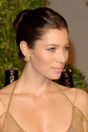 Jessica Biel paired her sleek bun with gold circle stud earring. The stunning actress showed off her dramatic bone structure with her sophisticated 'do. The gold jewelry topped off her elegant look.