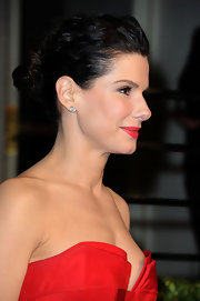 Sandra Bullock pulled her long brunette locks back in a twisted bun at the 2011 'Vanity Fair' Oscar party.