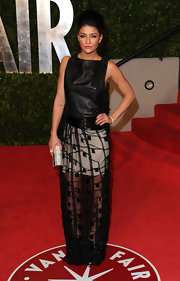 Jessica Szohr added shine to her 'Vanity Fair' Oscar party look with a glimmering silver clutch.