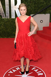 Anna Paquin complemented her 'Vanity Fair' Oscar party look with black velvet Donna pumps adorned with red bows.