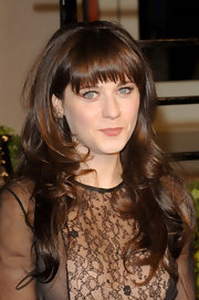 Zooey Deschanel rocked long curls and blunt cut bangs at the 2011 Vanity Fair party.