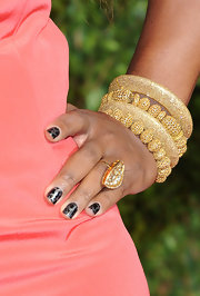 Serena Williams graced the red carpet a the 2011 'Vanity Fair' party wearing a gold gemstone cocktail ring.