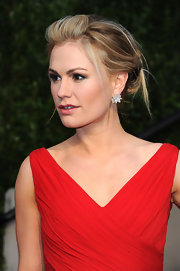 Anna Paquin accented her loose bun with a diamond earring studs.