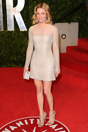 Elizabeth Banks added sparkle to her Oscar party look with nude crystal-encrusted Viola sandals.