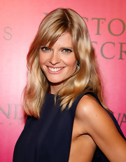 Anja Rubik were her hair simple and straight with side-swept bangs at the 2011 Victoria's Secret Fashion Show after party.