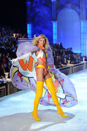 Anja Rubik's legs seemed to go on for miles in these thigh-high yellow boots at the Victoria's Secret fashion show.